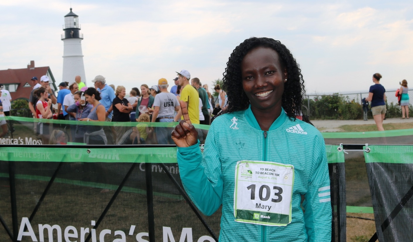PHOTO: Mary Keitany after shattering the course record at the TD Beach to Beacon 10-K in Cape Elizabeth, Me. (photo by Chris Lotsbom for Race Results Weekly)