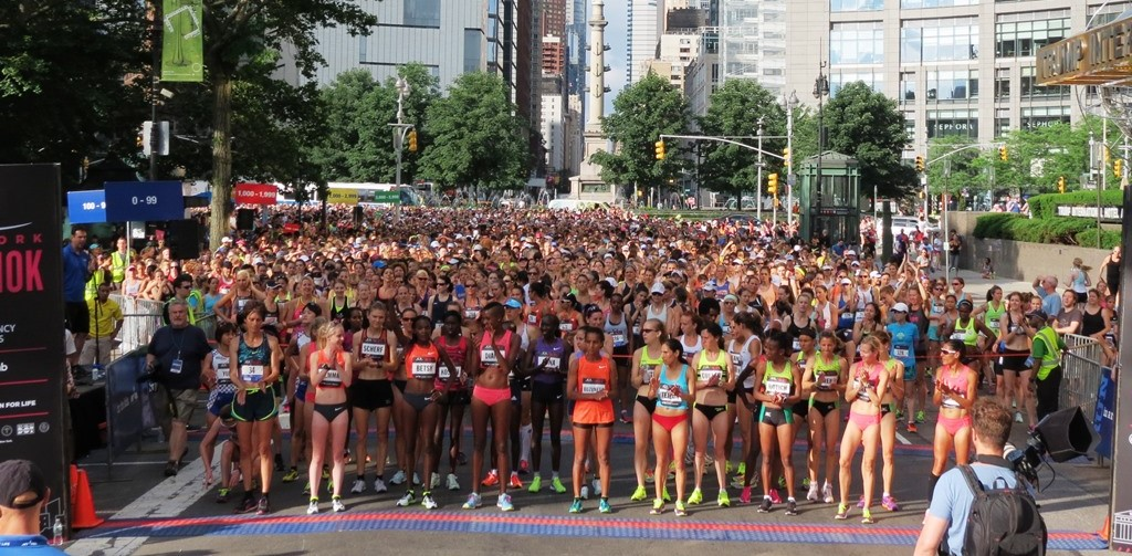 PHOTO: The start of the 2015 NYRR New York Mini 10-K on Central Park West with Columbus Circle in the background (photo by David Monti for Race Results Weekly)