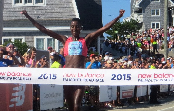 PHOTO: Diane Nukuri winning the 2015 New Balance Falmouth Road Race (photo by Chris Lotsbom for Race Results Weekly)