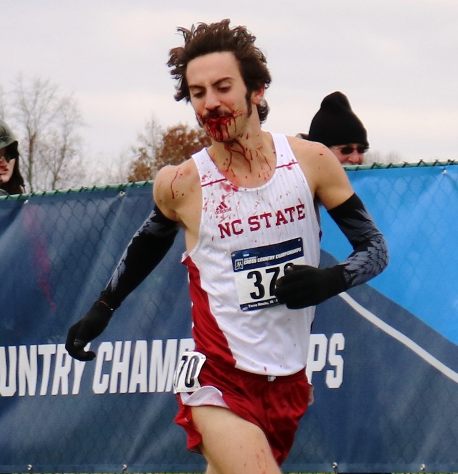 PHOTO: Eli Moskowitz of North Caroline State competing at the 2016 NCAA Division I Cross Country Championships after a bad fall (photo by Chris Lotsbom for Race Results Weekly)
